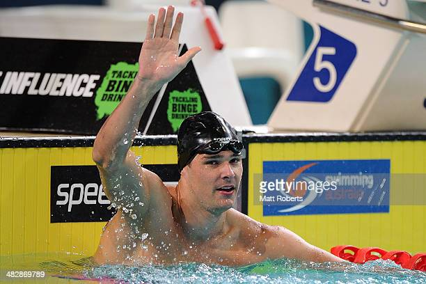 Christian Sprenger celebrates winning the final of the Mens 50 metre Breaststroke event during the 2014 Australian Swimming Championships at Brisbane...