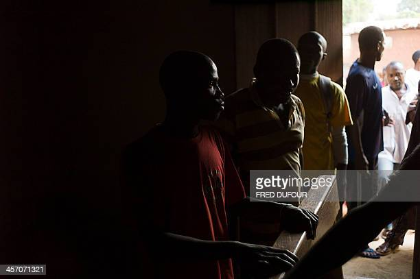 A christian stands with muslim people inside a church of a mosque of Kina neighborhood an area where members of the two religions decided to unite to...