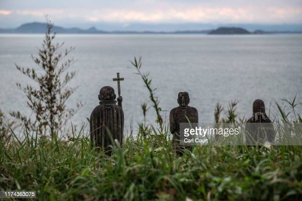 Christian statues including one holding a cross are pictured at the ruins of Hara Castle which was the final battleground of an uprising of Christian...