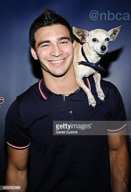 Christian Stoinev and pet Scooby attend America's Got Talent season 9 post show red carpet event at Radio City Music Hall on August 6 2014 in New...
