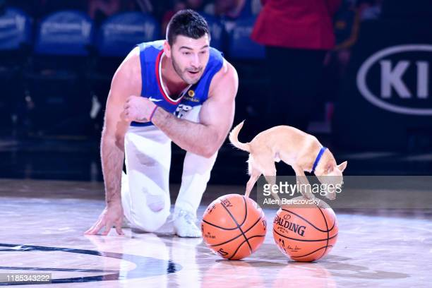 Christian Stoinev and Scooby perform during halftime of a basketball game between the Los Angeles Clippers and the Utah Jazz at Staples Center on...
