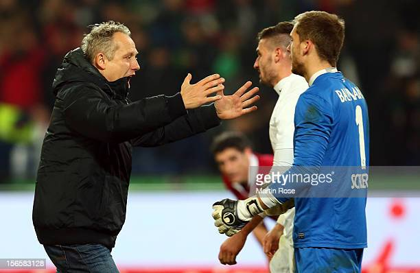 Christian Streich , head coach of Freiburg celebrate with goalkeeper Oliver Baumann after the Bundesliga match between Hannover 96 and SC Freiburg at...