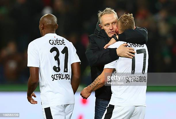 Christian Streich , head coach of Freiburg celebrate with Jonathan Schmid after the Bundesliga match between Hannover 96 and SC Freiburg at AWD Arena...