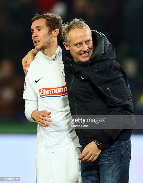 Christian Streich , head coach of Freiburg celebrate with Julian Schuster after the Bundesliga match between Hannover 96 and SC Freiburg at AWD Arena...