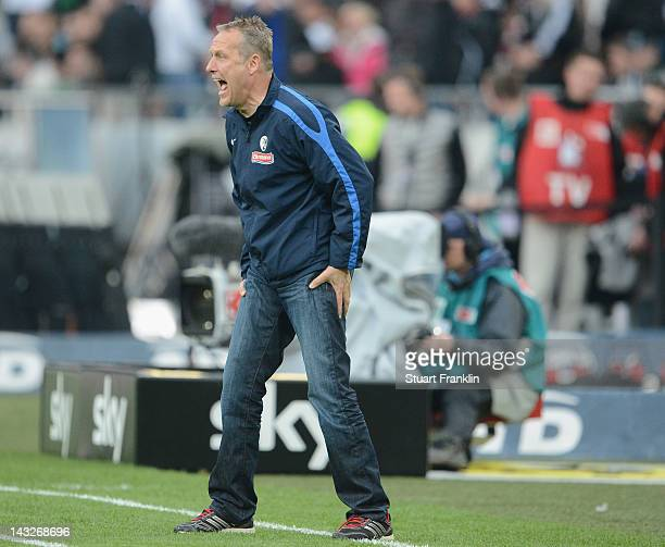 Christian Streich head coach of Freiburg gestures during the Bundesliga match between Hannover 96 and SC Freiburg at AWD Arena on April 22 2012 in...