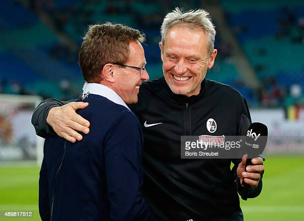 Christian Streich head coach of Freiburg hugs Ralf Rangnick head coach of Leipzig prior to theSecond Bundesliga match between RB Leipzig and SC...