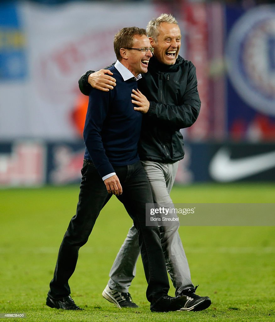 Christian Streich (R), head coach of Freiburg hugs Ralf Rangnick, head coach of Leipzig after the Second Bundesliga match between RB Leipzig and SC Freiburg at Red Bull Arena on September 24, 2015 in Leipzig, Germany.