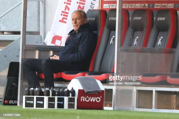 Christian Streich, head coach of Freiburg looks on during the Bundesliga match between Sport-Club Freiburg and RB Leipzig at SC-Stadion on October...