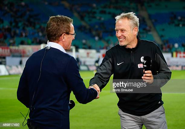 Christian Streich head coach of Freiburg shake hands with Ralf Rangnick head coach of Leipzig prior to theSecond Bundesliga match between RB Leipzig...