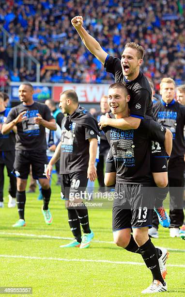 Christian Strohdiek and Michael Heinloth of Paderborn celebrate their promotion to the Bundesliga during the match between SC Paderborn and VFR Aalen...