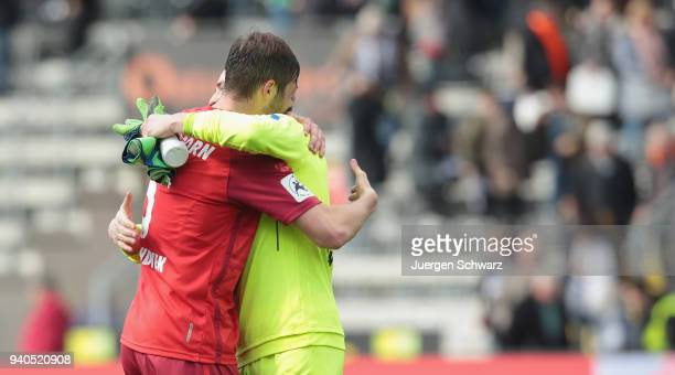 Christian Strohdiek of Paderborn and goalkeeper Michael Ratajczak celebrate after the 3 Liga match between VfR Aalen and SC Paderborn 07 at Ostalb...