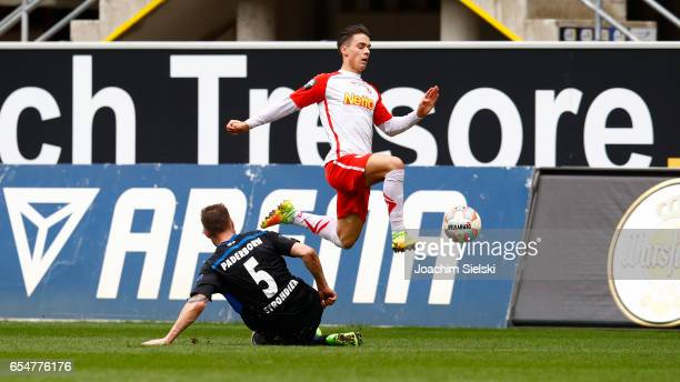 Christian Strohdiek of Paderborn challenges Erik Thommy of Regensburg during the third league match between SC Paderborn and Jahn Regensburg at...