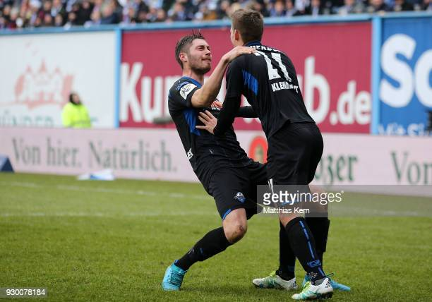 Christian Strohdiek of Paderborn jubilates with team mate Philipp Klement after scoring the fived goal during the 3Liga match between FC Hansa...