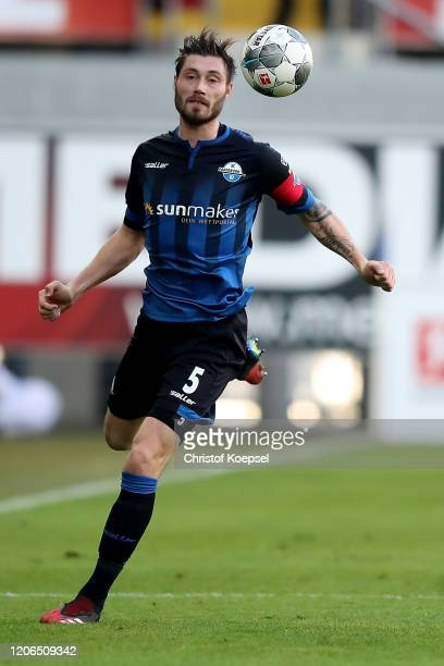 Christian Strohdiek of Paderborn runs with the ball during the Bundesliga match between SC Paderborn 07 and Hertha BSC at Benteler Arena on February...