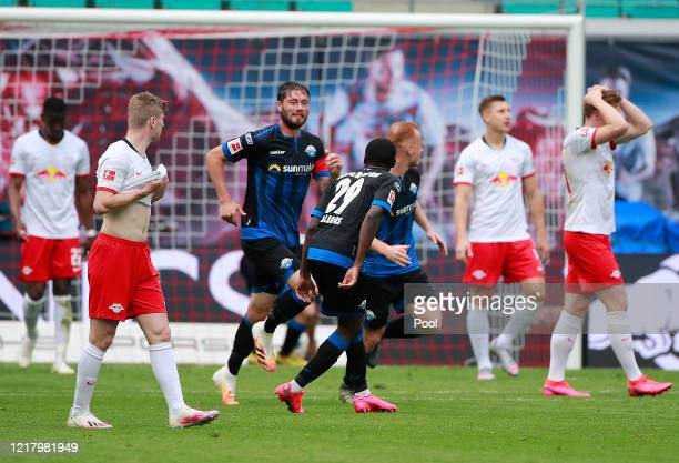 Christian Strohdiek of SC Paderborn celebrates scoring his side's first goal during the Bundesliga match between RB Leipzig and SC Paderborn 07 at...