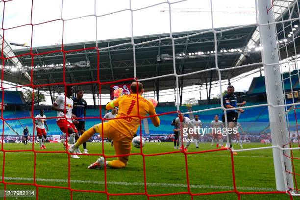 Christian Strohdiek of SC Paderborn scores his sides first goal past Peter Gulacsi of RB Leipzig during the Bundesliga match between RB Leipzig and...