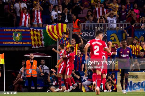 Christian Stuani of Girona FC celebrates after scoring his sides second goal during the La Liga match between FC Barcelona and Girona FC at Camp Nou...