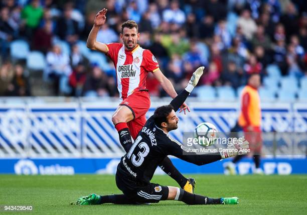 Christian Stuani of Girona FC duels for the ball with Antonio Ramirez of Real Sociedad during the La Liga match between Real Sociedad de Futbol and...