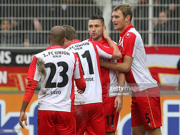 Christian Stuff of Berlin jubilates with team mates after scoring the first goal during the Second Bundesliga match between 1.FC Union Berlin and TSV...