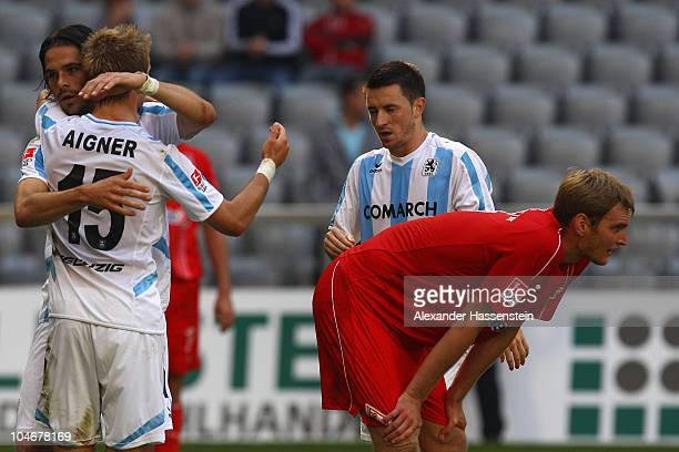 Christian Stuff of Berlin looks on whilst Stefan Buck of Muenchen celebrates victory with his team mates Stefan Aigner and Antonio Rukavina after the...