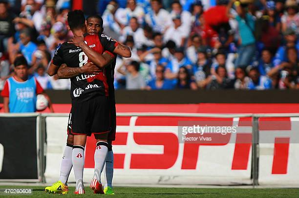 Christian Suarez of Atlas celebrates with teammates after scoring the first goal of his team during a match between Puebla and Atlas as part of 14th...