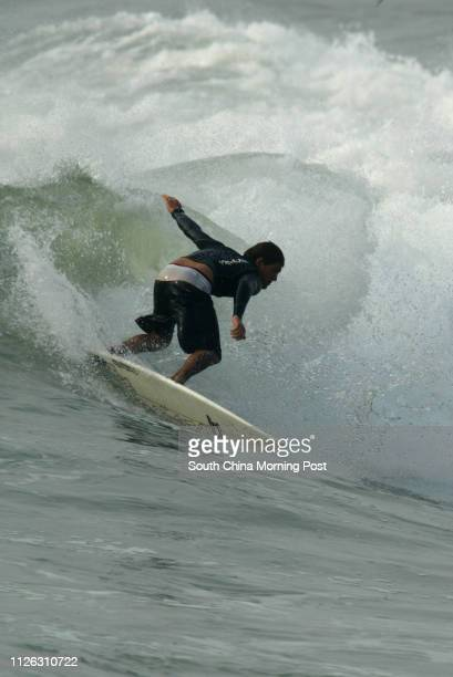 Christian surfer Justin Rigby in Action during the 720 China Surf Open surfing competition in Cherry Point Shanwei China 07 DECEMBER 2003