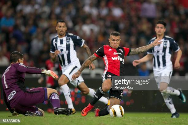 Christian Tabo of Atlas fights for the ball with Hugo Gonzalez goalkeeper of Monterrey during the quarter finals first leg match between Atlas and...