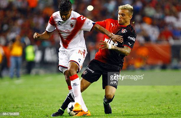 Christian Tabo of Atlas vies for the ball with Luis Sanchez of Veracruz during their Mexican Apertura 2016 tournament football match at Jalisco...