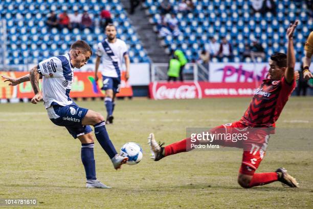 Christian Tabo of Puebla and Hibert Ruiz of Veracruz fight a ball during a match between Puebla and Veracruz as part of Torneo Apertura Liga MX at...
