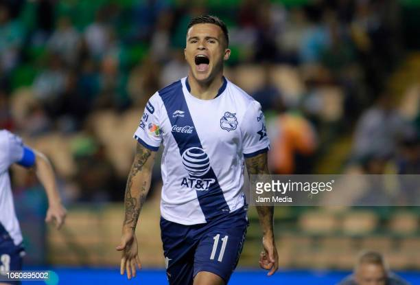 Christian Tabo of Puebla celebrates after scoring the firts goal of his team during the 14th round match between Leon and Puebla as part of the...