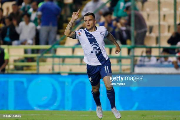 Christian Tabo of Puebla celebrates after scoring the second goal of his team during the 14th round match between Leon and Puebla as part of the...
