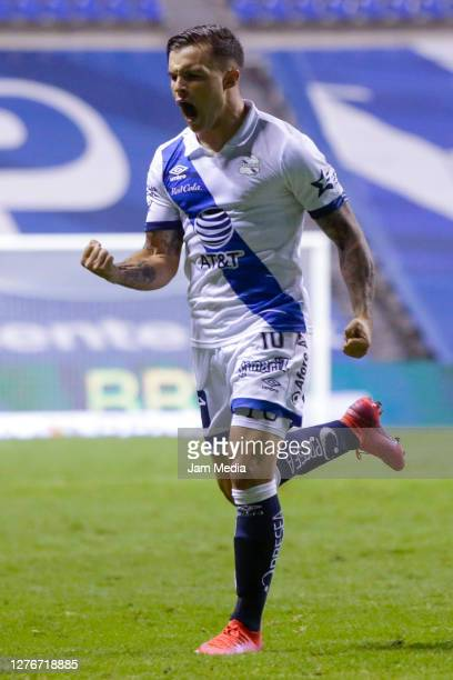 Christian Tabo of Puebla celebrates after scoring the third goal of his team during the 12th round match between Puebla v Queretaro as part of the...