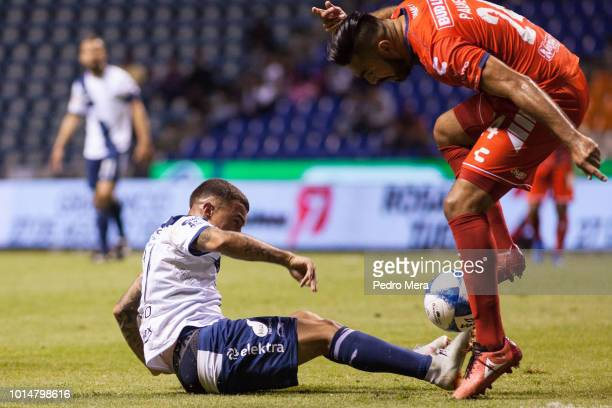 Christian Tabo of Veracruz slides against Jose Rivas of Veracruz during the 4th round match between Puebla and Veracruz as part of the Torneo...
