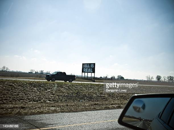 Christian themed sign is posted on the highway surrounded by farms on February 5, 2012 in Cincinnati, Ohio.
