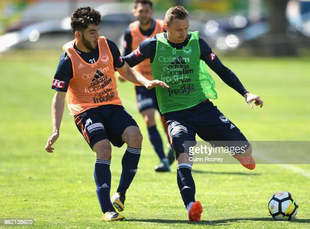 Christian Theoharous and Besart Berisha of the Victory compete for the ball during a Melbourne Victory ALeague training session at Gosch's Paddock on...