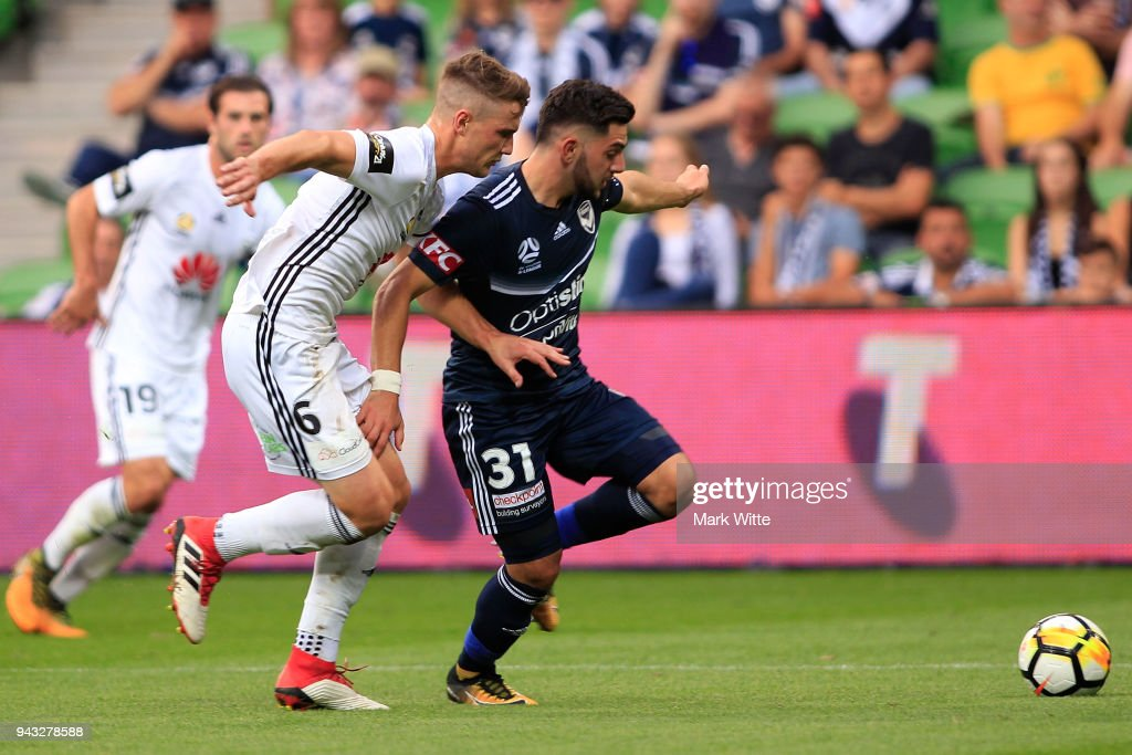 Christian Theoharous of Melbourne Victory and Dylan Fox of Wellington Phoenix both fight for the ball during the round 26 A-League match between the Melbourne Victory and the Wellington Phoenix at AAMI Park on April 8, 2018 in Melbourne, Australia.