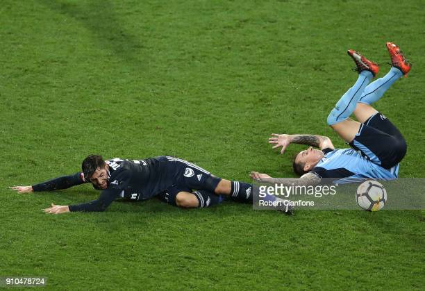 Christian Theoharous of the Victory challenges Luke Wilkshire of Sydney FC during the round 18 ALeague match between Melbourne Victory and Sydney FC...
