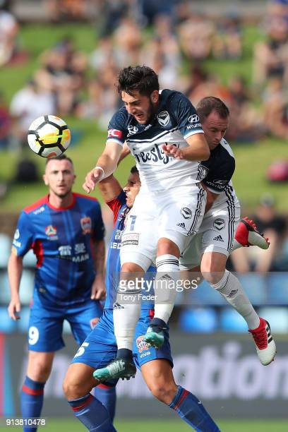 Christian Theoharous of the Victory contests a header during the round 19 ALeague match between the Newcastle Jets and the Melbourne Victory at...
