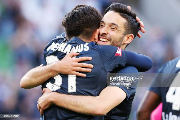 Christian Theoharous of the Victory is hugged by Stefan Nigro of the Victory after he scored a goal during the round 23 ALeague match between the...