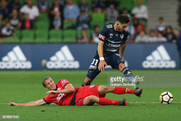 Christian Theoharous of the Victory is tackled during the round 21 ALeague match between the Melbourne Victory and Adelaide United at AAMI Park on...