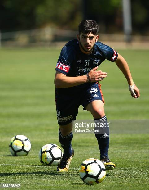 Christian Theoharous of the Victory runs with the ball during a Melbourne Victory ALeague training session at Gosch's Paddock on November 29 2017 in...