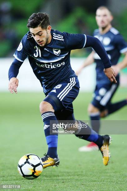 Christian Theoharous of the Victory runs with the ball during the AFC Asian Champions League match between the Melbourne Victory and Kawasaki...