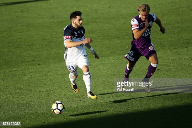 Christian Theoharous of the Victory runs with the ball during the round seven ALeague match between Perth Glory and Melbourne Victory at nib Stadium...