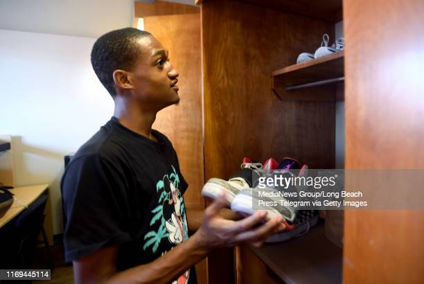 Christian ThomasSpeller gets creative trying to store his many shoes in the dorm room closet at Cal State University Long Beach in Long Beach on...