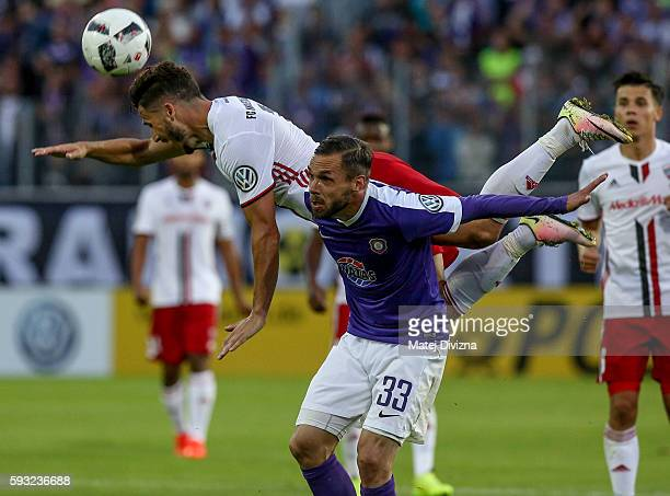 Christian Tiffert of Aue competes for the ball with Mathew Leckie of Ingolstadt during the DFB Cup match between Erzgebirge Aue and FC Ingolstadt at...
