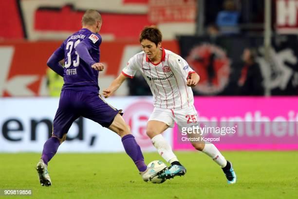 Christian Tiffert of Erzgebirge Aue challenges Genki Haraguchi of Duesseldorf during the Second Bundesliga match between Fortuna Duesseldorf and FC...