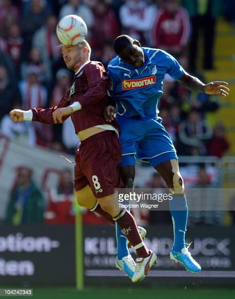 Christian Tiffert of Kaiserslautern battles for the ball with Demba Ba of Hoffenheim during the Bundesliga match between 1FC Kaiserslautern and TSG...