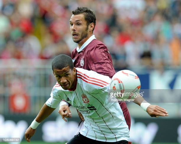 Christian Tiffert of Kaiserslautern battles for the ball with Nathan Eccelston of Liverpool during the internatonal preseason friendly match between...