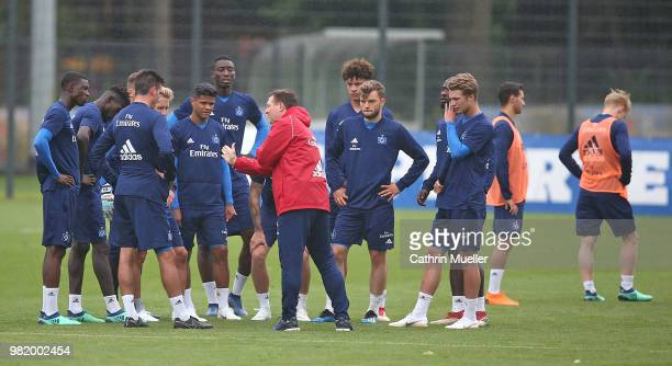 Christian Titz head coach of Hamburger SV gives the player some tactical instructions during the first training session of the new season at...