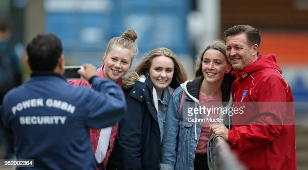 Christian Titz head coach of Hamburger SV make some selfies with the fans after the first training session of the new season at Volksparkstadion on...